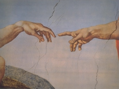 """detail of Michaelangelo's painting """"The Creation of Adam"""" on the Sistine Chapel."""