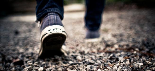 man walking on gravel