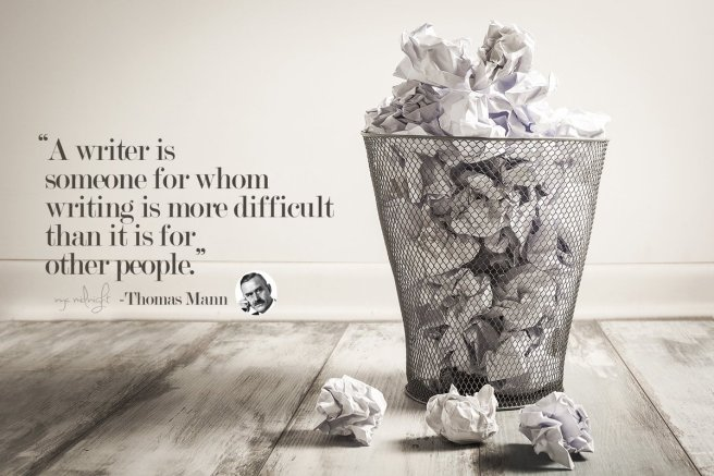 Crumpled papers in a wastepaper basket.