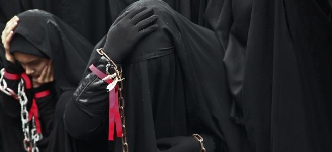 Muslim woman mourning in black niqabs.